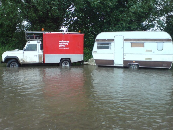 Recovering caravans from a flooded rally field (remember the Gloucester floods?) Saul Festival 2007
