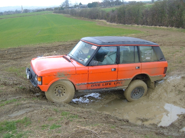 Tomo in the V8 Rangie, gets caught out by and is hung up at the back (Picture by Roger Taylor)